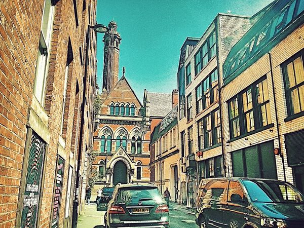 Architecture Building Exterior Built Structure City Day Car Outdoors Sky Manchester UK EyeEmNewHere Urban City Centre Brick Wall Summer Street Warmlight Overlooking Buildings Bright Sky Tower Old And New Parked Car Van Window Reflections Teal Blue Pedestrian