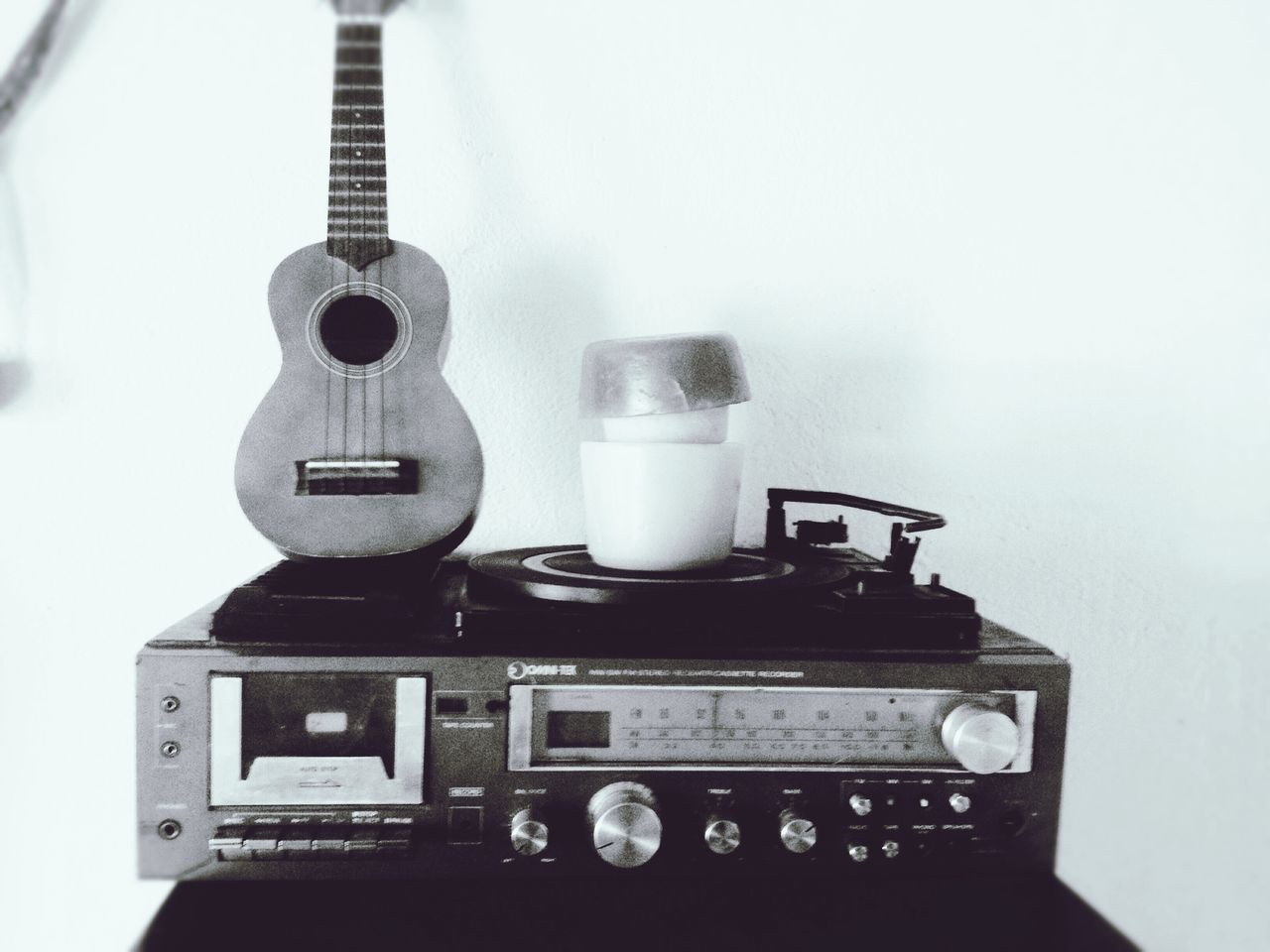 music, retro styled, musical instrument, old-fashioned, arts culture and entertainment, musical equipment, old, still life, guitar, indoors, single object, technology, no people, antique, close-up, white background, musical instrument string, fretboard, record player needle, day