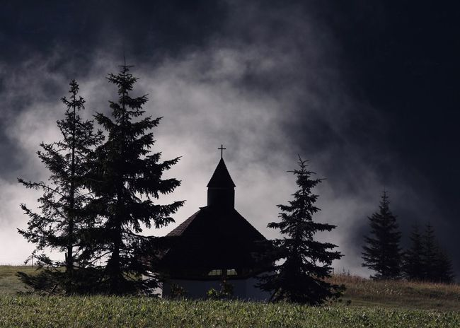 Chapel In The Alps Against Morning Dusk Chapel Church Tree Plant Sky Architecture Nature Religion Place Of Worship Spirituality Belief Land Field Grass Outdoors Spire  Growth Cloud - Sky Dusk Fog Copy Space Travel Alps Arlberg Atmospheric Mood