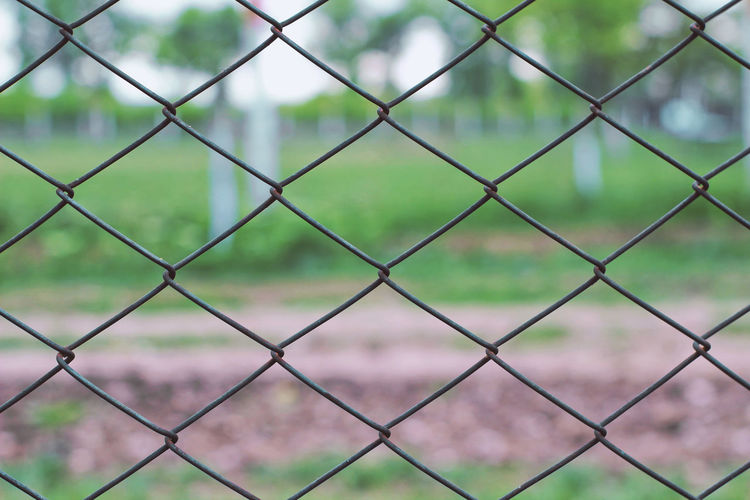 Textured  Textures and Surfaces Backgrounds Barrier Boundary Chainlink Fence Close Up Close-up Crisscross Day Fence Field Focus On Foreground Full Frame Metal Nature No People Outdoor Photography Outdoors Pattern Playing Field Protection Safety Security Texture