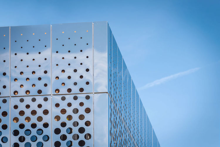 Morning view reflecting shiny modern building surface on blue sky in background Modern Architecture The Architect - 2018 EyeEm Awards Architecture Blue Building Exterior Built Structure Clear Sky Copy Space Day Futuristic Architecture Geometric Shape Low Angle View Metal Modern Nature No People Outdoors Pattern Shape Silver Colored Sky Spotted Steel Sunlight