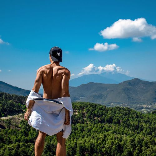 Shirtless Mountain One Person Sky Cloud - Sky Rear View Nature Leisure Activity Real People Non-urban Scene Men Scenics - Nature Mountain Range Lifestyles Three Quarter Length Plant Day Standing Outdoors Beauty In Nature