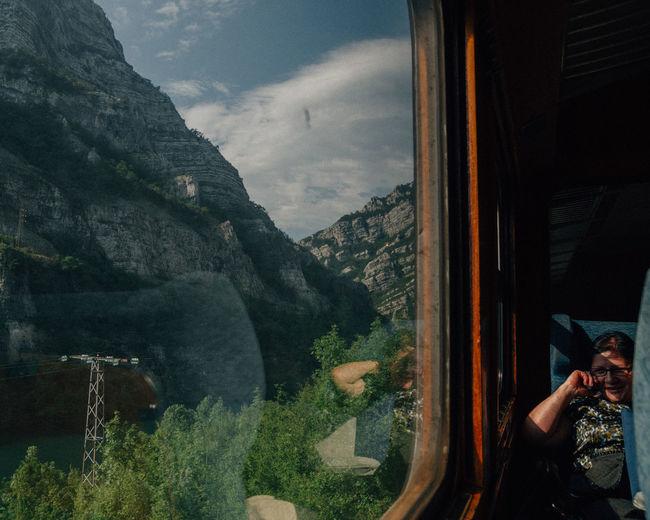 Reflection of man on glass window