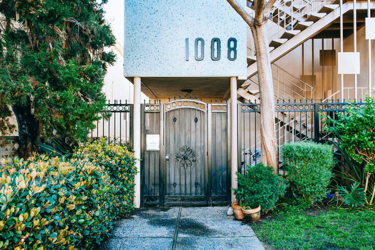 Santa Monica, LA Architecture Building Exterior Built Structure Closed Day Door Entrance Footpath Gate Green Color Growth House Ivy Nature No People Outdoors Plant The Way Forward Tree Wall - Building Feature