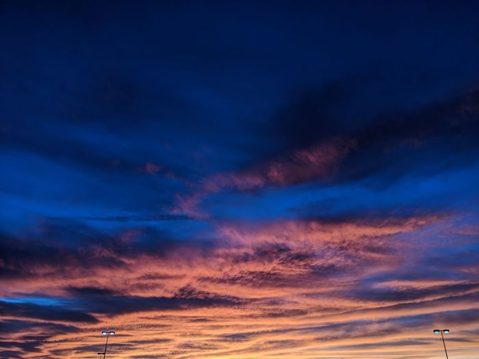 Low angle view of dramatic sky at sunset.