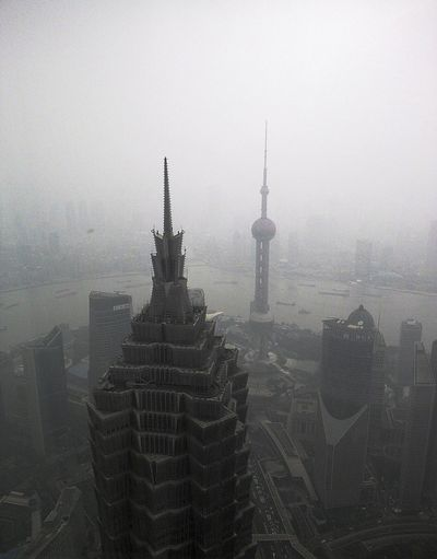 High angle view of cityscape in foggy weather