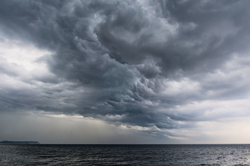 Clouds on the Baltic Sea coast. Baltic Sea Beauty In Nature Climate Cloud - Sky Coast Day Extreme Weather Horizon Over Water Nature No People Ominous Outdoors Rain Ruegen Rügen Scenics Sea Shore Sky Storm Storm Cloud Thunderstorm Water Weather