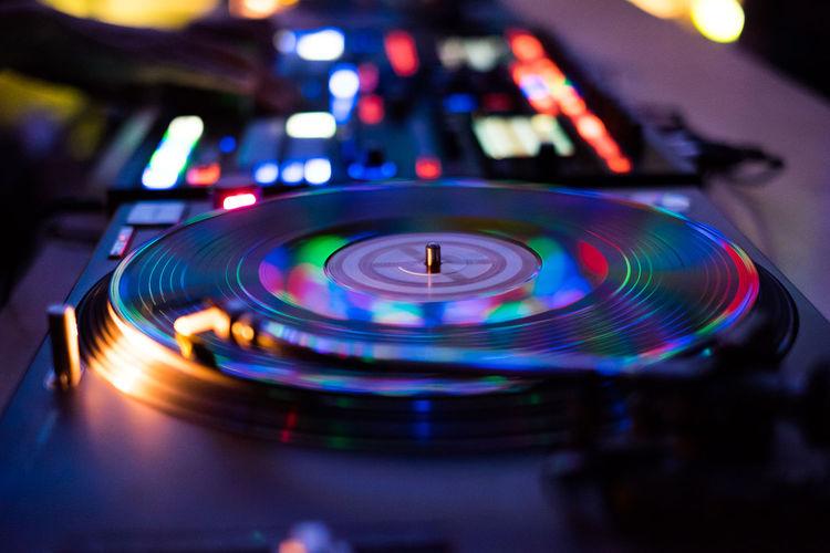 Close-up of dj turntable at nightclub