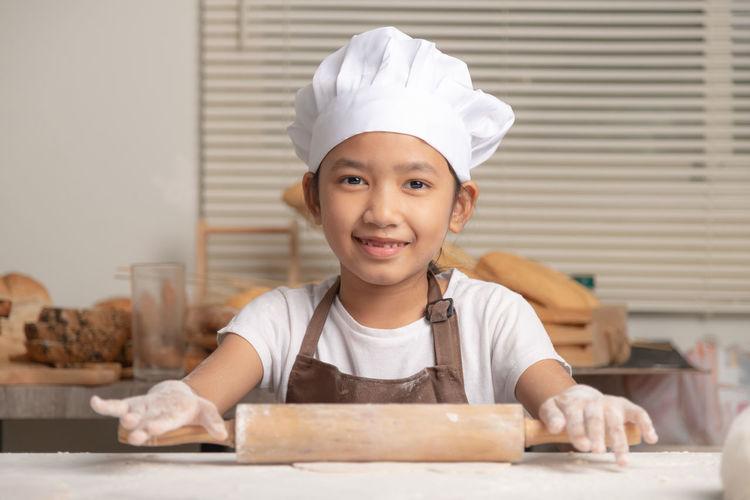Portrait of smiling girl eating food