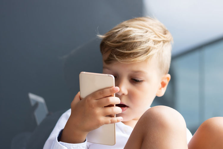 Portrait of boy using mobile phone