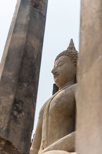 Sculpture Human Representation Art And Craft Statue Male Likeness Low Angle View Representation Religion Architecture Belief Spirituality Built Structure Creativity No People Place Of Worship Travel Destinations Day Outdoors Idol Architectural Column Ancient Civilization