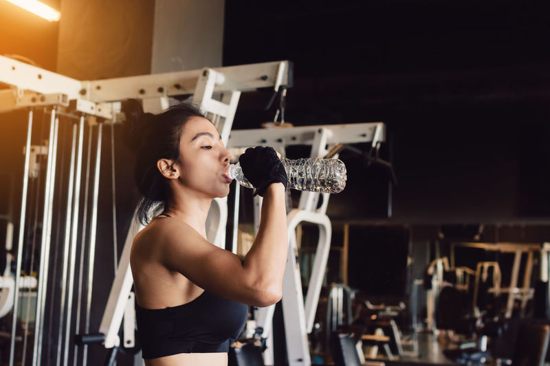 Woman Drinking Water In Gym