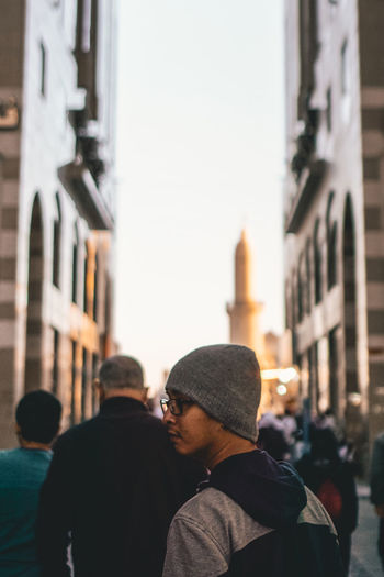 Architecture Building Exterior Men Built Structure Real People City Lifestyles Leisure Activity Adult Focus On Foreground People Building Clothing Rear View Two People Standing Incidental People City Life Street Males  Outdoors Warm Clothing Medina Al Munawarah