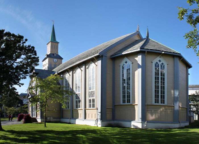 Apse and nave of the wooden Domkirke Church in Tromso, Norway Apse Architecture Basilica Building Exterior Built Structure Cathedral Choir  Church Construction Domkirke Façade Gothic Style Historical Sights Landmark Lawn Monument Nave Neo-Gothic Norway Ochre Color Painted Tromsø Windows Wood - Material Wooden