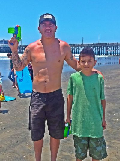 My Pictures of Emilio and Me in Newport Beach California CA Dadbod Dad Bod Rancho Cucamonga Ranchocucamonga Newportbeach Orange County Orangecounty  BackstageGabe Backstage Gabe Fathersday Beach Water Sea Portrait Standing Child Smiling Happiness Men Summer Swimming Trunks Beach Holiday