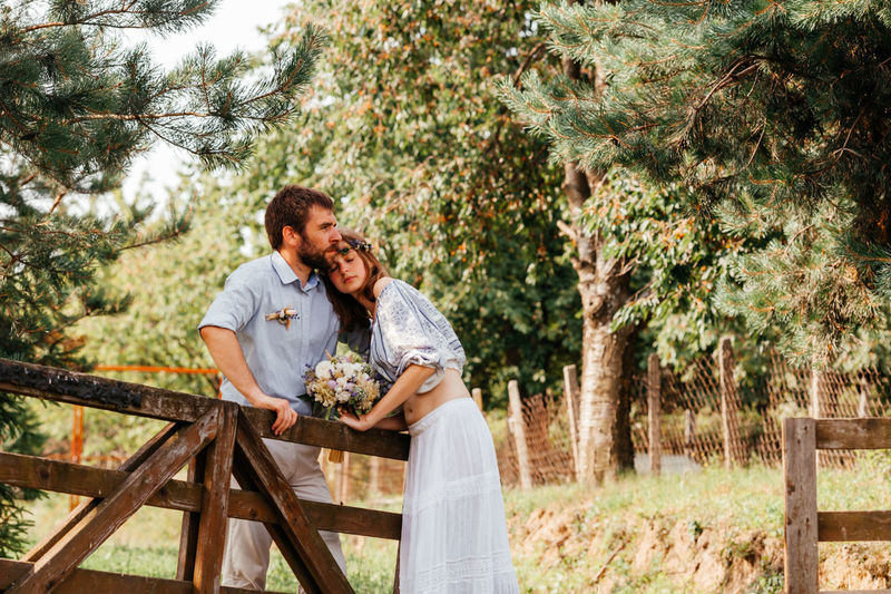 Newlywed couple embracing outdoors