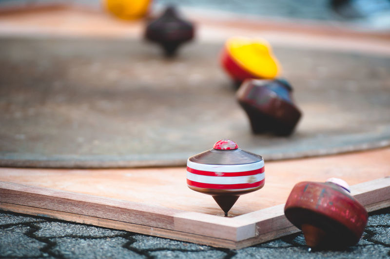 Close-up of spinning tops on table