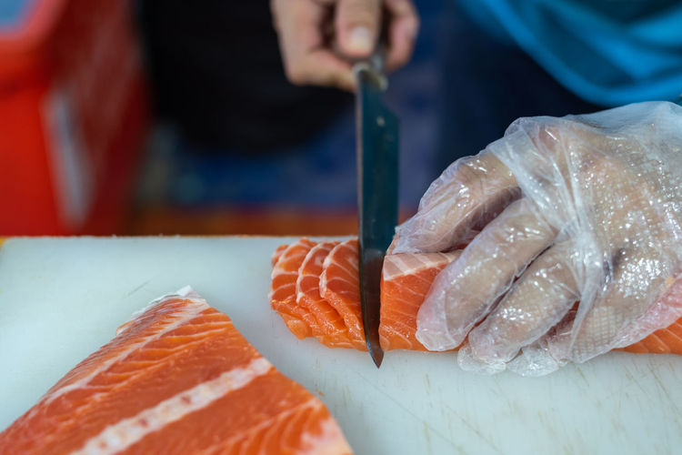 Asian Food Close-up Fish Focus On Foreground Food Food And Drink Freshness Hand Healthy Eating Holding Human Body Part Human Hand Indoors  Japanese Food One Person Preparation  Rice Salmon - Seafood Sashimi  Seafood Sushi