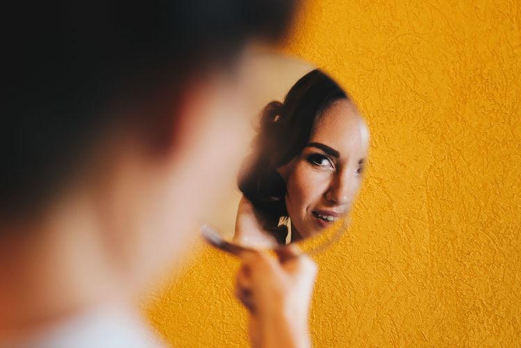 Wedding Portrait Preparation  Bride Mua Makeup Orange Color Visual Creativity Portrait Young Women Beautiful Woman Beauty Yellow Looking At Camera Beautiful People Human Face Headshot Close-up Eye Make-up