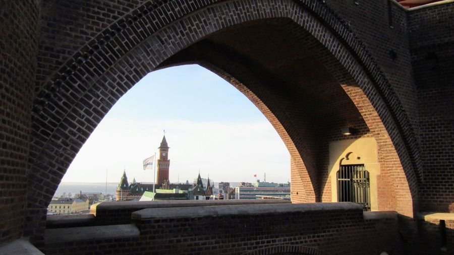 Arch bridge and buildings against sky