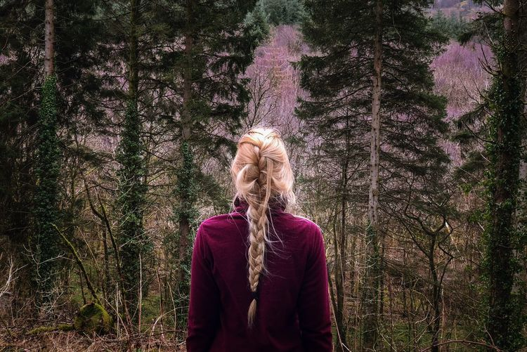 Messy braids, happy adventures. Wales UK Adventure Girl Lifestyles Woods One Person Real People Plant Lifestyles Leisure Activity Growth Standing Adult Women Hairstyle Waist Up Nature Hair Long Hair Outdoors Human Hair Tree Go Higher