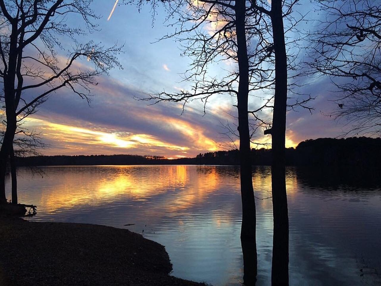 sunset, reflection, cloud - sky, sky, tree, silhouette, scenics, beauty in nature, orange color, water, nature, tranquility, dramatic sky, tranquil scene, no people, lake, outdoors, travel destinations, bare tree, day