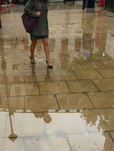 When it rains, it pours Challenging City Life Day Lifestyles Mirrored Outdoors Pavement Rain Rainy Day Rainy Days Reflections Tough Roads Unrecognizable Person Woman With Heels Puddle Reflections Puddle Of Water Reflected Person Woman In High Heels Reflections Of A Woman
