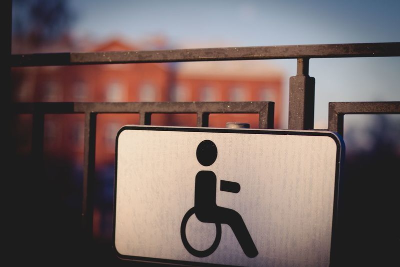 Disabled Sign On Railing