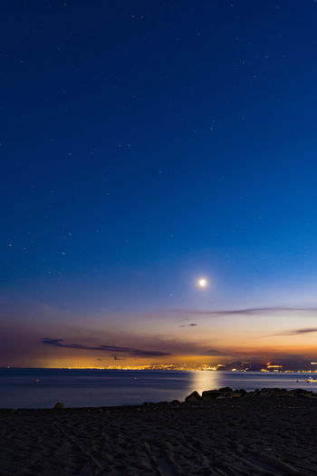 Astronomy Beach Beauty In Nature Blue Clear Sky Constellation Galaxy Horizon Over Water Moon Nature Night No People Outdoors Scenics Sea Sky Space Star - Space Sunset Tranquil Scene Tranquility Water