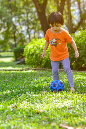 Children girl play football Childhood Child Boys Offspring Plant Full Length One Person Nature Innocence Grass Leisure Activity Outdoors