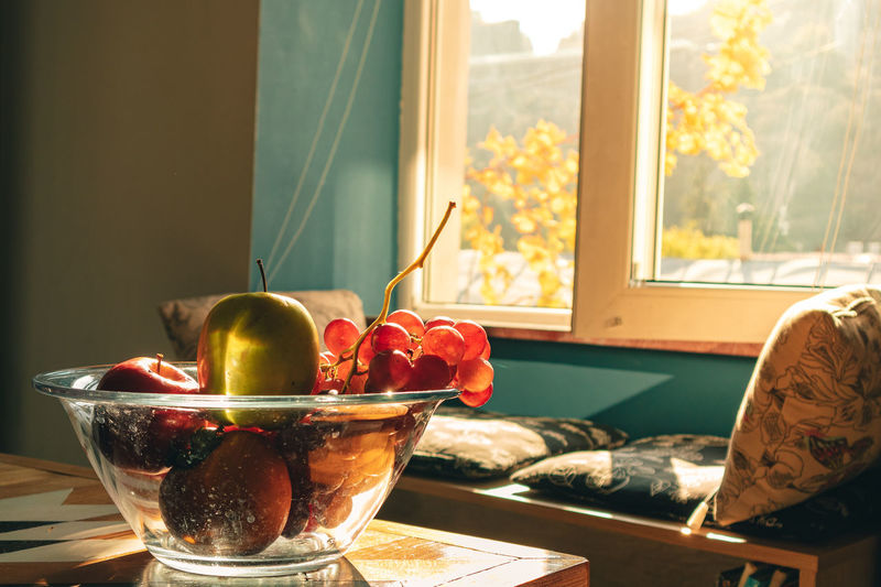 Close-up of fruits in glass bowl on table