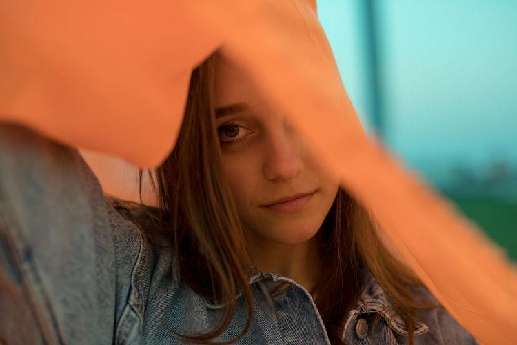 Portrait of woman wearing orange textile outdoors