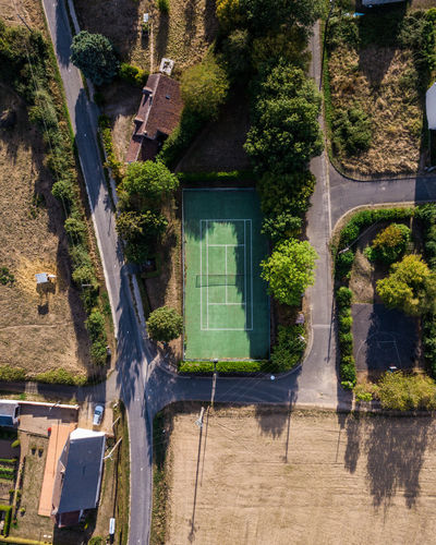 High angle view of empty sports court amidst trees