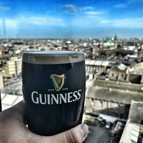 Can't say no to a Guinness in Dublin Outdoors Photography Photooftheday Photographer Beauty In Nature Neverstopexploring  Explore More Photo Human Hand Close-up Focus On Foreground Sky Human Body Part Text One Person Human Finger Day Holding Real People Nature People