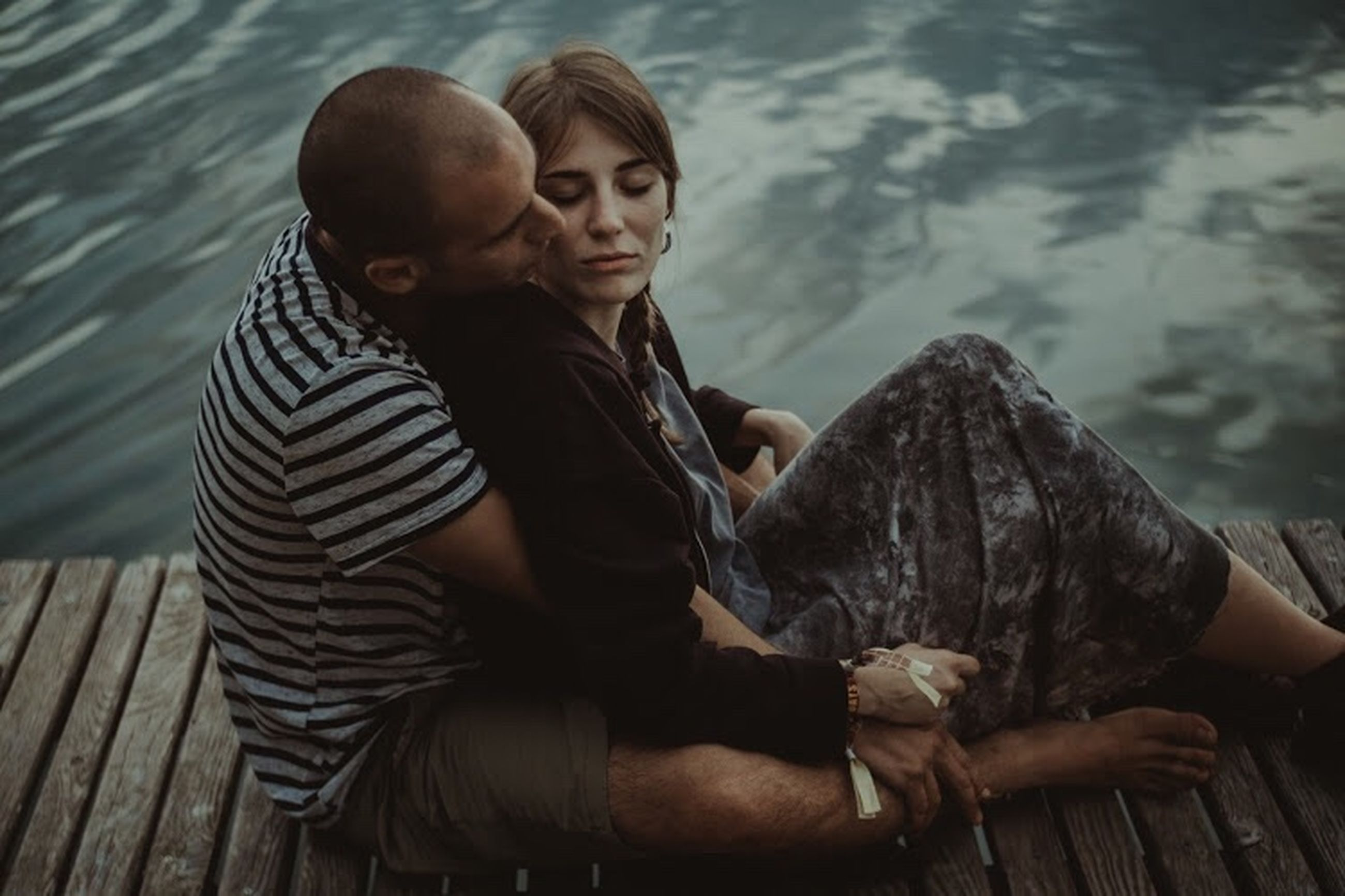 two people, water, togetherness, men, sitting, adult, animal wildlife, young adult, women, positive emotion, casual clothing, people, animals in the wild, mid adult, three quarter length, couple - relationship