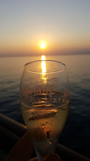 Sunset Water Sun Drink Sea Refreshment Close-up Beach Sky Drinking Glass Alcohol Gold Colored Sunlight Focus On Foreground Cold Temperature Outdoors No People Scenics Cloud - Sky Horizon Over Water Croisieres De France Croisiere Msc MSC FANTASIA Nature