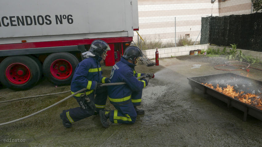 Training day. Close Up Couple Day Duo Fire Firefighter Full Frame Job Jobs Occupation Panasonic Lx100 Real People RISK Risky Business Side By Side Smoke Training Water Work Working Working