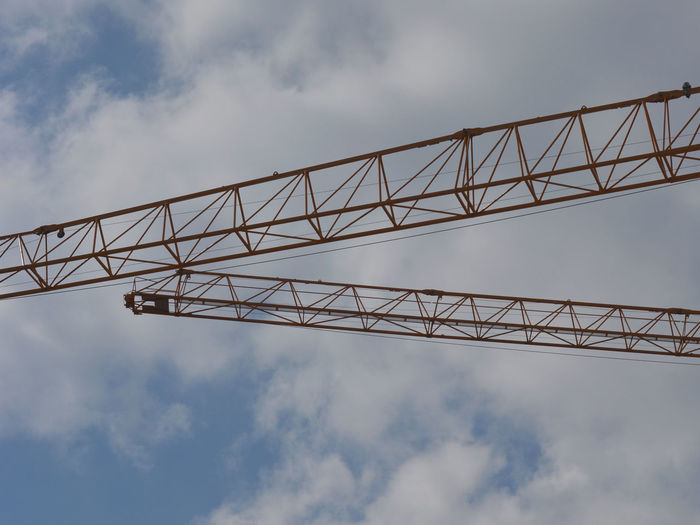 Architecture Building Built Structure Cloud - Sky Connection Construction Construction Site Crane Crane - Construction Machinery Cranes Cranes And Construction Day Engineering Low Angle View Metal No People Outdoors Sky
