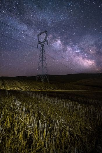 Star - Space Night Long Exposure Astronomy Electricity  Field Star Field Cable Electricity Pylon Space Rural Scene Constellation Fuel And Power Generation Landscape Nature Technology Beauty In Nature Wind Power Sky Wind Turbine