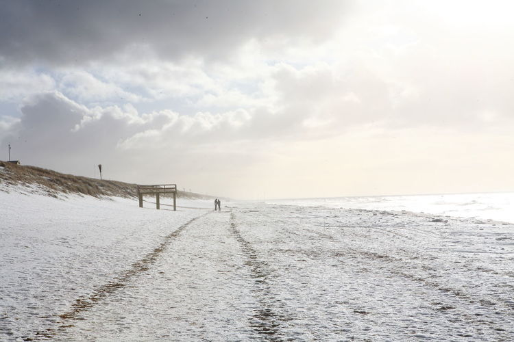 Beach Cloud - Sky Endlesness Going For A Walk Horizon Over Water Landscape People And Places People Together Road To Nowhere Sand Sea Snowy Sylt Germany Sylt In Winter Sylt Strand Tranquil Scene Tranquility Wave Winter Wintertime Wintertime On Sylt