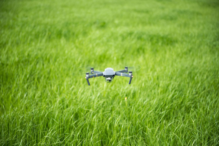 Drone Hovering Above Field