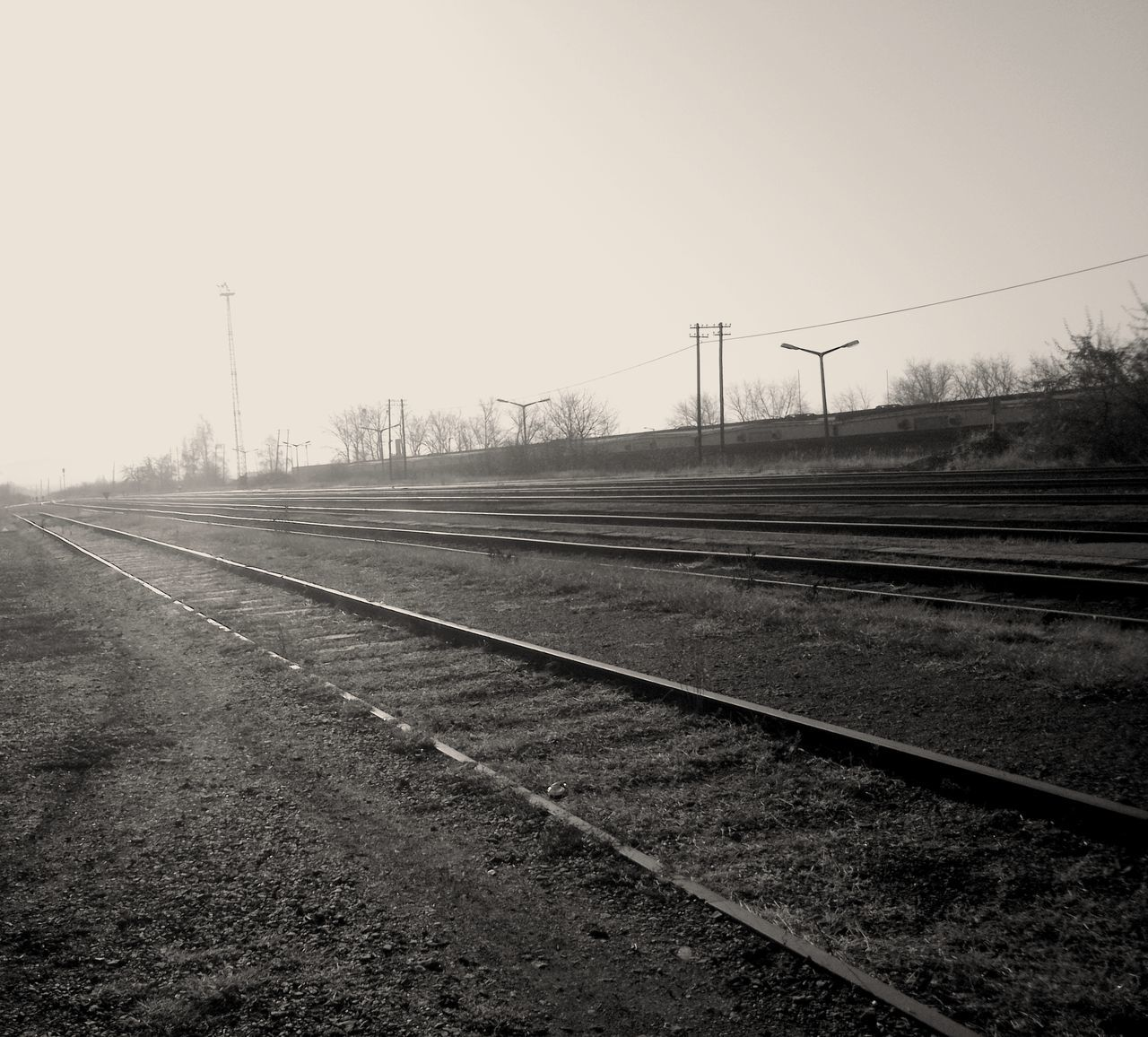 rail transportation, railroad track, transportation, no people, clear sky, railway track, outdoors, day, nature, sky