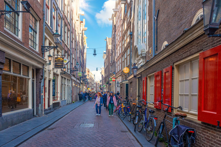 City street in Amsterdam Architecture Building Exterior Built Structure City Group Of People Building Street Real People Men Women Adult Transportation Crowd Nature Day People Walking Outdoors Amsterdam Amsterdam City
