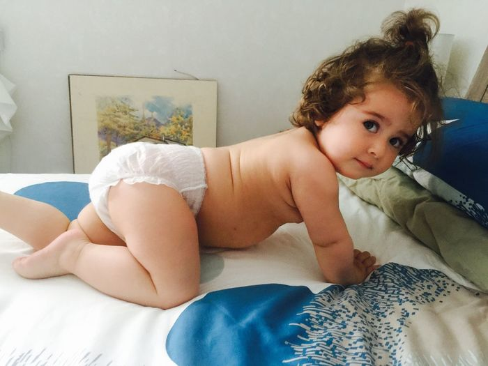 Portrait Bed Indoors  Real People Home Interior Full Length One Person Baby Bedroom Childhood Shirtless Lifestyles Lying Down Looking At Camera Pillow Day Diaper Baby Boss Masterpiece Art Summer Mood