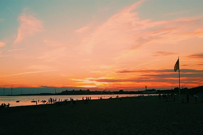 Sunset Sea Beach Water Sky Silhouette Outdoors Beauty In Nature Horizontal Dramatic Sky Vacations Romantic Sky Nature No People Day