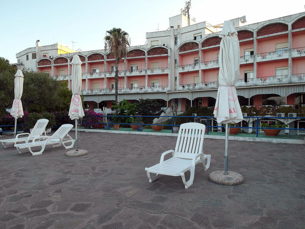 Hotel Calabria (Italy) Palm Palm Tree South Italy Architecture Building Exterior Built Structure Calabria Chairs Deck Chairs Hotel Hotel View No People Outdoors Umbrellas