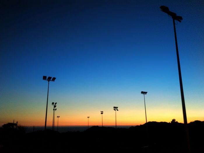 Street Light Silhouette Lighting Equipment Night Blue Floodlight No People Clear Sky Low Angle View Outdoors Sunset Illuminated Sky Nature Beauty In Nature