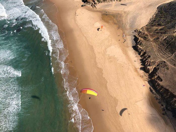 Paragliding Over Water Paragliding Over Beach
