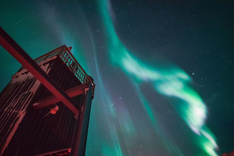 Aurora borealis and old industrial building