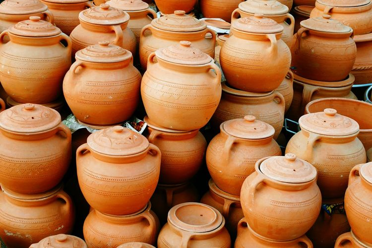 Full frame shot of clay containers for sale at market stall